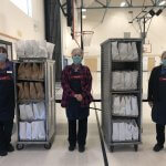 Nutrition Services Employees with sack lunches